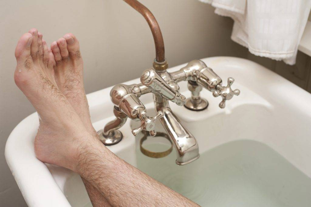 """Alt=""""relaxing-in-tub-after-bathtub-reglazing-dry-time"""""""